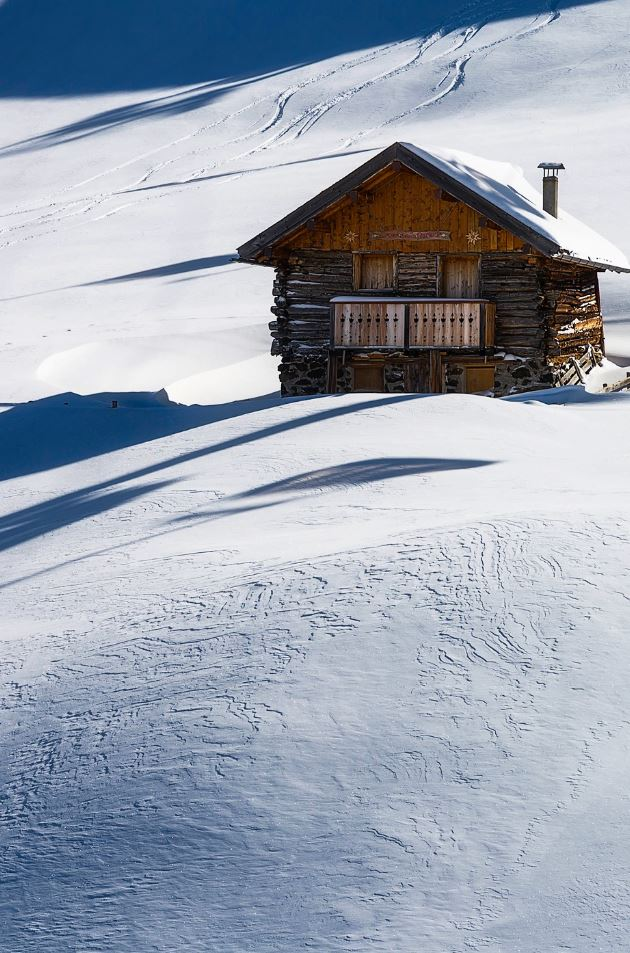 Wooden House on Snow
